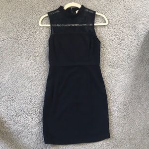 Dark navy blue dress with lace detail on top.
